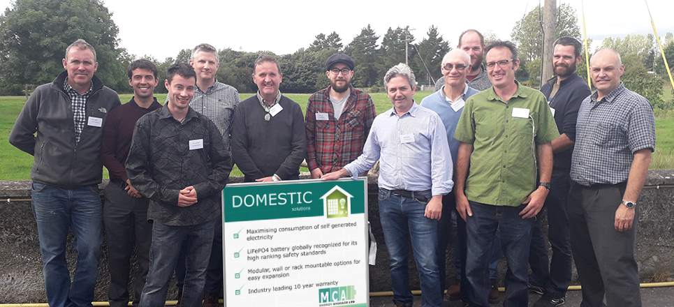 Image showing about 10 men, all Solar PV installers with BYD experts at recent training workshop at MCA offices in Kilkenny. They are learning about batteries for Solar PV.